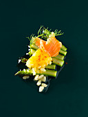 Risotto cubes with green asparagus and salmon (molecular gastronomy)