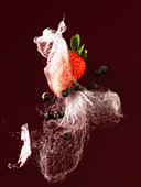 Strawberries with capers and cotton candy (molecular gastronomy)