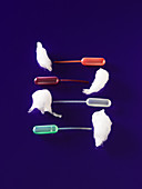 Collection of vegetable juice in pipettes served with cotton candy