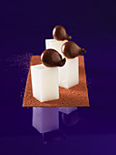Solid and liquid cocoa on milk cubes (molecular gastronomy)