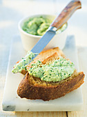 Trout cream cheese with wild herbs on toasted bread