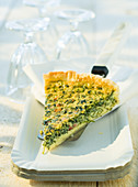 A slice of quiche with ground elder