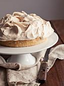 Lemon Meringue Pie on White Cake Stand