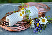 Napkin ring handmade from copper wire and wildflowers