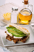 Delicious Arepa stuffed with avocado, cheese and meat