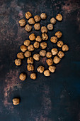Walnuts on black rusty surface