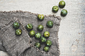 Fresh greengages on grey cloth