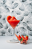 Fresh watermelon Daiquiri, refreshing cocktail in glass cup on light background