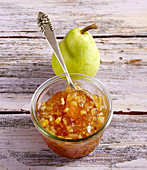 Homemade pear jam on a wooden background