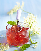 Homemade elderflower and rose wine jelly with fresh mint in a glass