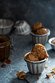 Coffee ice cream with toffee sauce and pecan nut praline