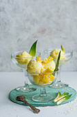 Pineapple and coconut sorbet with fresh pinaple pieces served in stem glasses