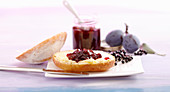 Damson and elderberry jam on a bread roll