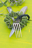 A wreath of sage with a knife and fork