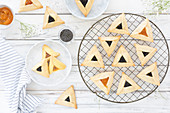 Jewish Hamantash biscuits with poppy and apricot filling