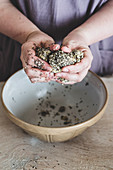 Hands kneading sesame cracker dough