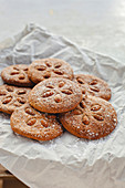 Homemade round shape ground almond cookies decorated with whole almonds