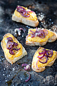 Crostini with pumpkin cream and red onions