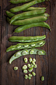 Fava beans on a wooden background