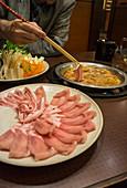 Shabu-shabu over a hot plate (Japan)