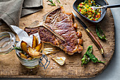 T-bone steak with potato wedges