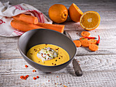 Fruity orange and carrot soup with ginger, chili and zucchini strips