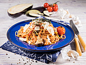 Spaghetti Siciliana with aubergine, cherry tomato, parmesan, thyme, rosemary and garlic