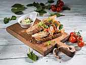 Turkey breast sandwich with tomato, spinach, chervil and roasted rye bread