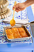 Baklava drizzled with syrup (Turkey)