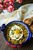 Mutton Keema Ghotala (spicy mutton mince) with a fried egg (India)