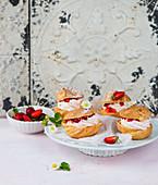 Cream puffs with strawberries