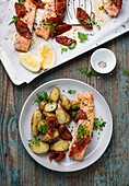 Salmon with dried tomatoes and potato salad