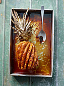 Caramelised Java pepper pineapple on stick with a rum and coconut sauce