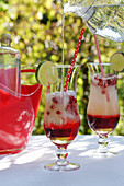 Pomegranate lemonade with ice cubes