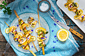 Salmon and lemon kebabs with mustard and herb marinade