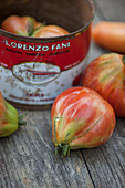 Organic tomatoes in and beside a metal tin