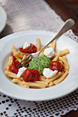 Strozzapreti with pesto and tomatoes