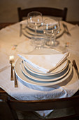 Two place settings on a rustic table