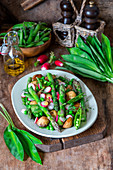 Asparagus salad with potatoes, peas and radishes