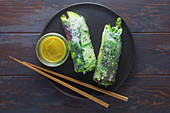 Vegan summer rolls with sticky rice, green asparagus and avocado