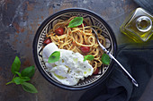 Spaghetti with pesto rosso and burrata