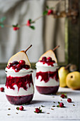 Yoghurt with cranberries and pears in glasses