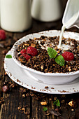 Granola with chocolate and raspberries