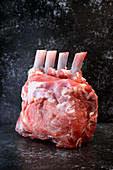 A raw lamb loin rack joint