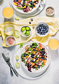 Spring mix salad with mango, blueberries and prosciutto