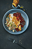 Chicken breast with couscous salad and pomegranate sauce