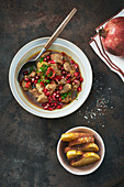 Pork goulash with pomegranate seeds