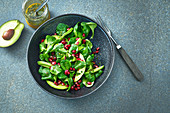 Corn salad with avocado and pomegranate seeds