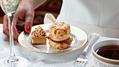 A BLT scone and a meringue cake for afternoon tea