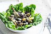 Artichokes à la jardinière with a green salad